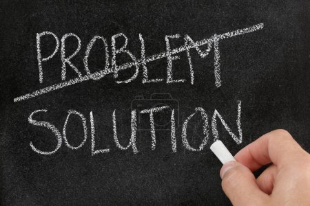 Photo for Crossing out the word problem and writing solution on blackboard - Royalty Free Image