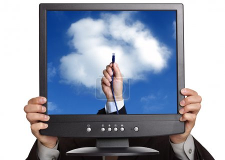 Photo pour Concept de cloud computing - busnessman tenant un écran d'ordinateur montrant une main reliant vers le nuage avec câble ethernet - image libre de droit