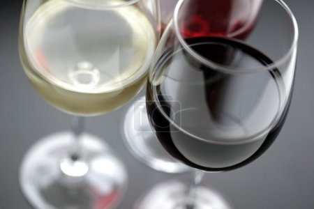 Photo for Three wineglasses with red, white and rose wine shallow depth of field - Royalty Free Image