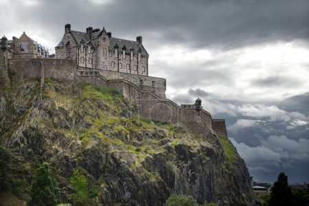 Photo for Dramatic lighting as storm clouds gather around Edinburgh Castle in Scotland - Royalty Free Image