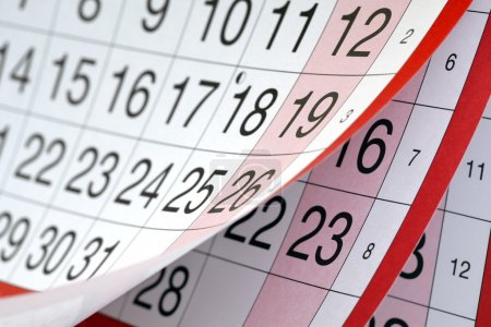 Months and dates shown on a calendar whilst turnin...