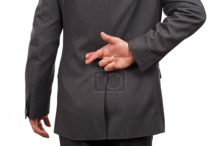 Photo for Businessman with his fingers crossed behind his back - concept for good luck or dishonesty - Royalty Free Image