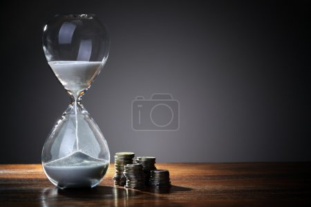 Photo for Deadline and time is money concept with hourglass and British coin currency - Royalty Free Image