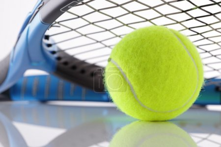 Photo for Tennis ball under the strings of a tennis racket - Royalty Free Image