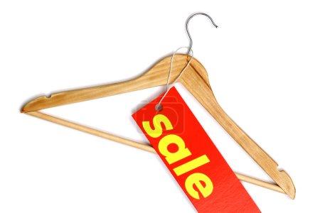 Wooden coat hanger with sale label