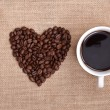 Heart shape made from coffee beans with a spoon an...