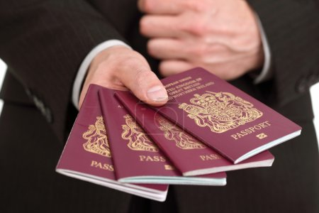 Presenting four British passports at the airport
