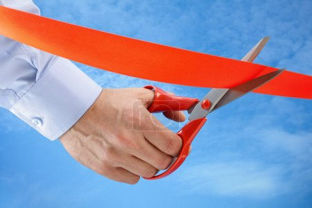 Cutting a red ribbon