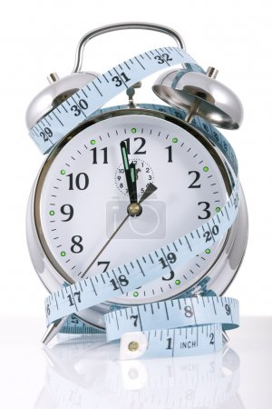 Photo for Clock and tape measure for diet concepts - Royalty Free Image