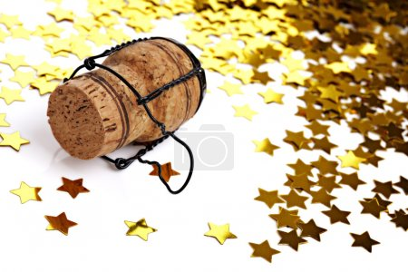 Foto de Año nuevo, boda, compromiso, fiesta de Navidad - confeti y corcho champagne - Imagen libre de derechos