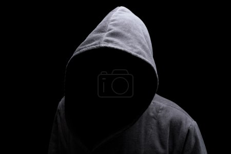 Photo for Menacing silhouette of hooded man in the shadow - Royalty Free Image