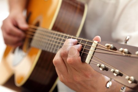 Photo for Man playing an acoustic guitar - Royalty Free Image