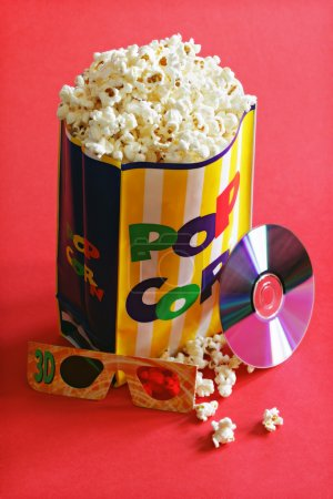 Photo for DVD movie, popcorn snack and 3d glasses ready for a night of entertainment - Royalty Free Image