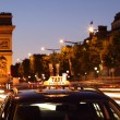 Постер, плакат: Paris taxi by the Arc de Triumph