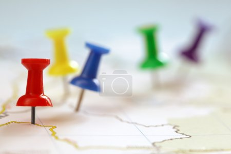 Photo for Travel destination points on a map indicated with colorful thumbtacks and shallow depth of field with space for copy - Royalty Free Image