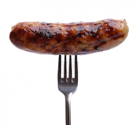 Grilled sausage on a fork against white background...