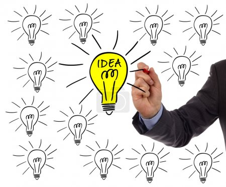 Photo for Businessman drawing a light bulb on a whiteboard concept for bright idea and inspiration - Royalty Free Image