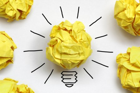 Photo for Inspiration concept crumpled paper light bulb metaphor for good idea - Royalty Free Image