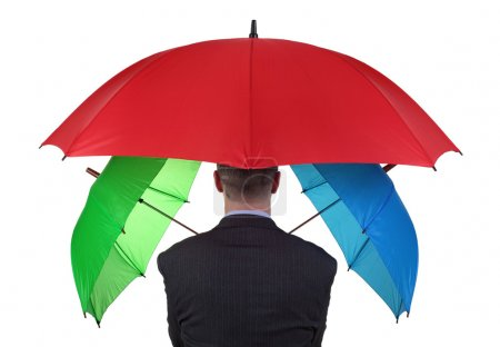 Photo pour Homme d'affaires confiant avec le concept de trois parasols pour plus que suffisant amplement d'assurance couverture ou failsafe plan de sauvegarde - image libre de droit