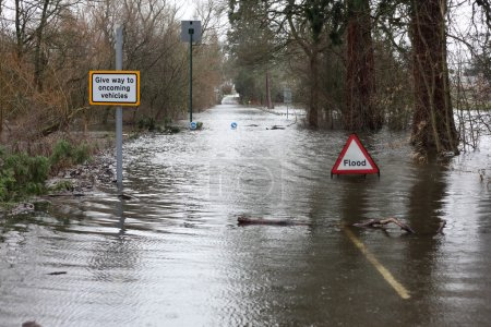 Road closed due to heavy rain and flood sign...