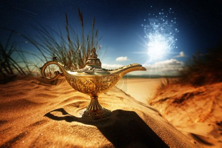 Photo for Magic lamp in the desert from the story of Aladdin with Genie appearing in blue smoke concept for wishing, luck and magic - Royalty Free Image