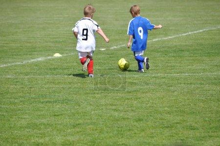 Children play soccer...