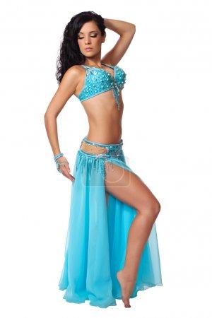 Belly dancer wearing a light blue costume.