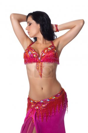 Beautiful belly dancer wearing a hot pink costume.