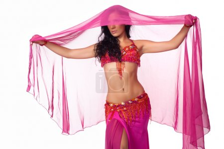 Exotic belly dancer wearing a hot pink costume and draped in a hot pink veil.