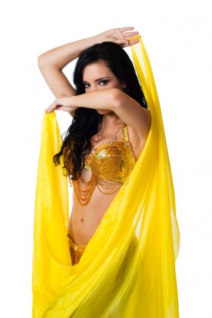 Exotic belly dancer wearing a gold costume