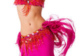 Torso of a female belly dancer wearing a hot pink costume shaking her hips.