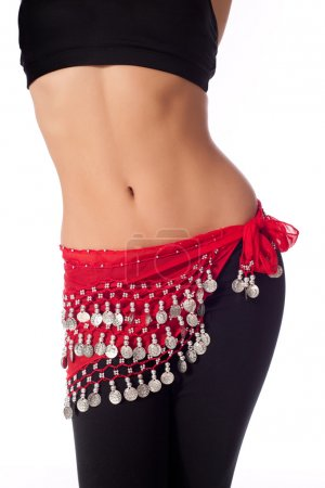Torso of an athletic female belly dancer.
