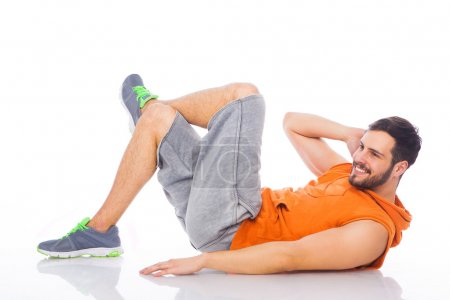 Young man doing exercises