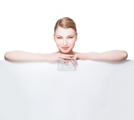 Beautiful expresive and natural woman lying on white panel