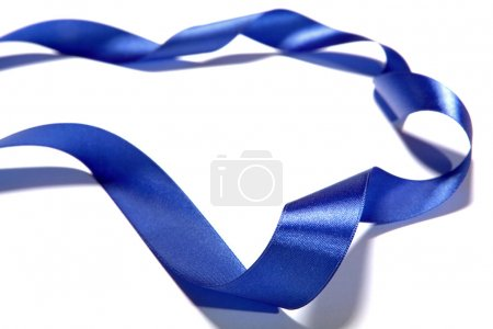 Blue fabric ribbon and bow on white background