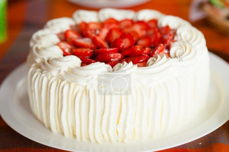 Photo for Delicious strawberry cake with strawberries and whipped cream - Royalty Free Image
