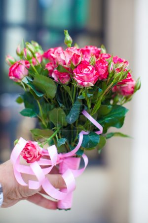 Charming bouquet of roses in woman's hand