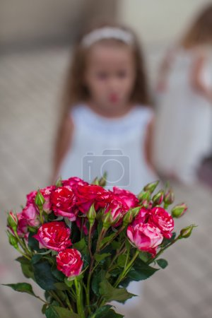 Charming bouquet of red roses in woman's hand background the girk
