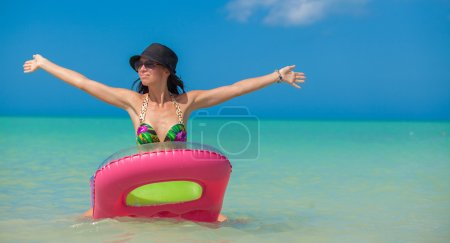 Young perfect woman on an air mattress in the sea