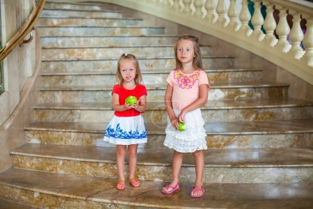 Adorable little girls in a big luxury hotel
