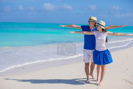 Young romantic couple have fun at Caribbean beach