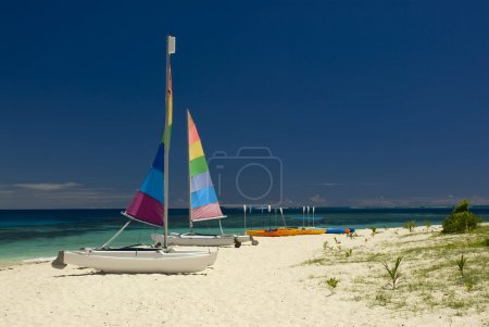 Catamarans and kayaks on sandy beach. Fiji, South pacific.