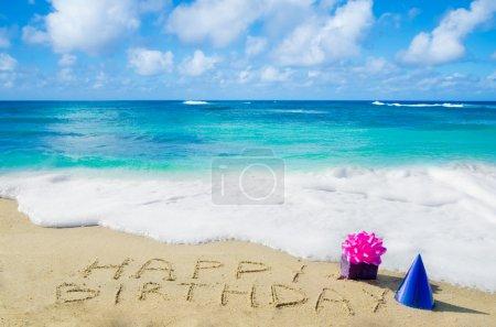 "Sign ""Happy Birthday"" on the sandy beach"