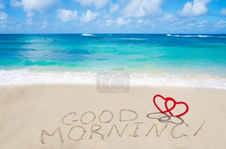 "Photo for Sign ""Good morning"" with two hearts on the sandy beach by the ocean - Royalty Free Image"