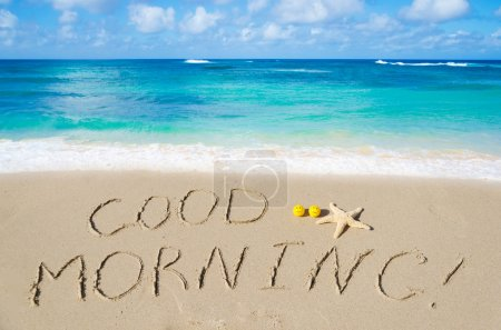 "Photo for Sign ""Good morning"" on the sandy beach - Royalty Free Image"