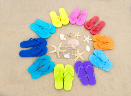 Color flip flops on sandy beach