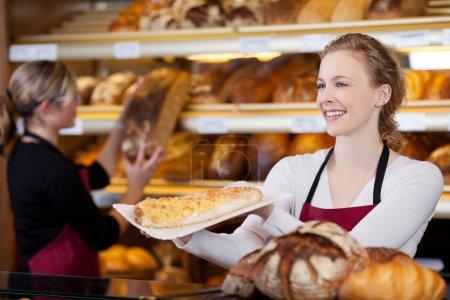smiling woman selling cake