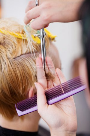 Woman with blond hair in the salon