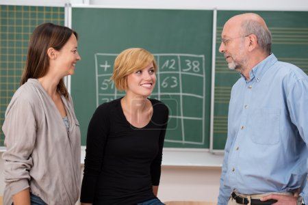Professor in class with two students