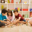 Children playing with blocks on the floor - focus ...